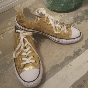 Women's gold low top Chuck Taylor Converse